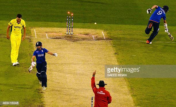 Umpire Aleem Dar raises his finger to give England's batsman James Taylor out lbw out as James Anderson fails to gain his ground and later declared...