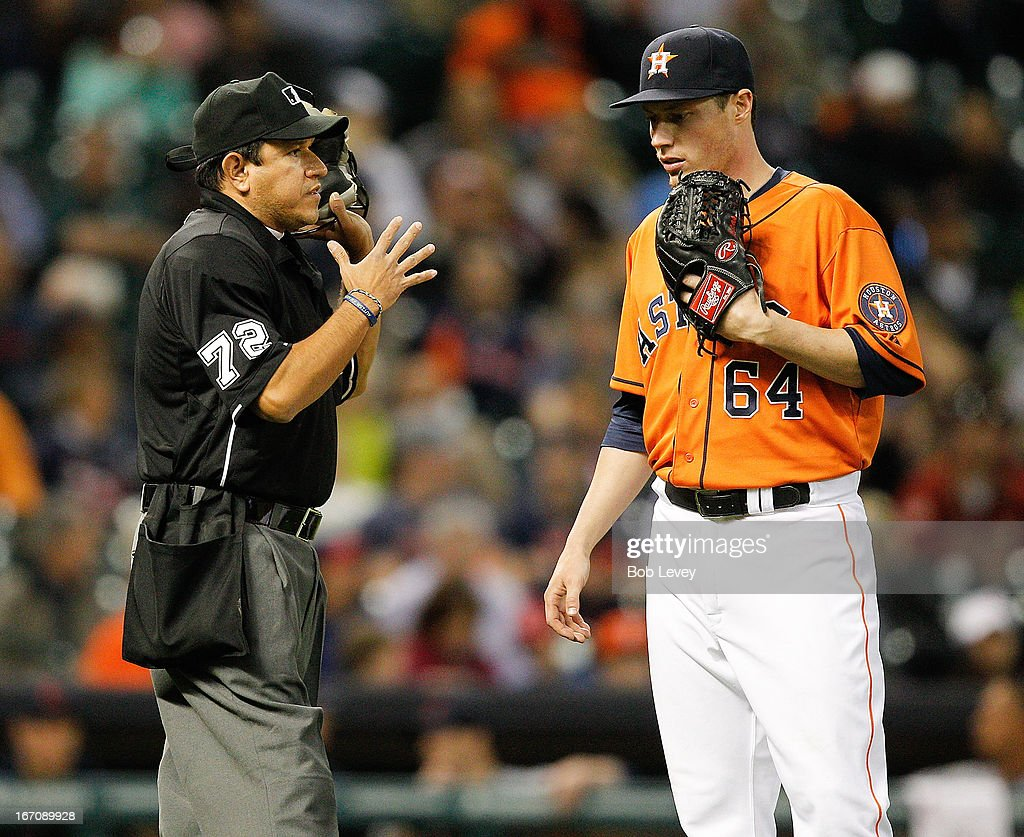 Umpire Alfonso Marquez talks with pitcher <a gi-track='captionPersonalityLinkClicked' href=/galleries/search?phrase=Lucas+Harrell&family=editorial&specificpeople=4946913 ng-click='$event.stopPropagation()'>Lucas Harrell</a> #64 of the Houston Astros during game action against the Cleveland Indians at Minute Maid Park on April 19, 2013 in Houston, Texas.