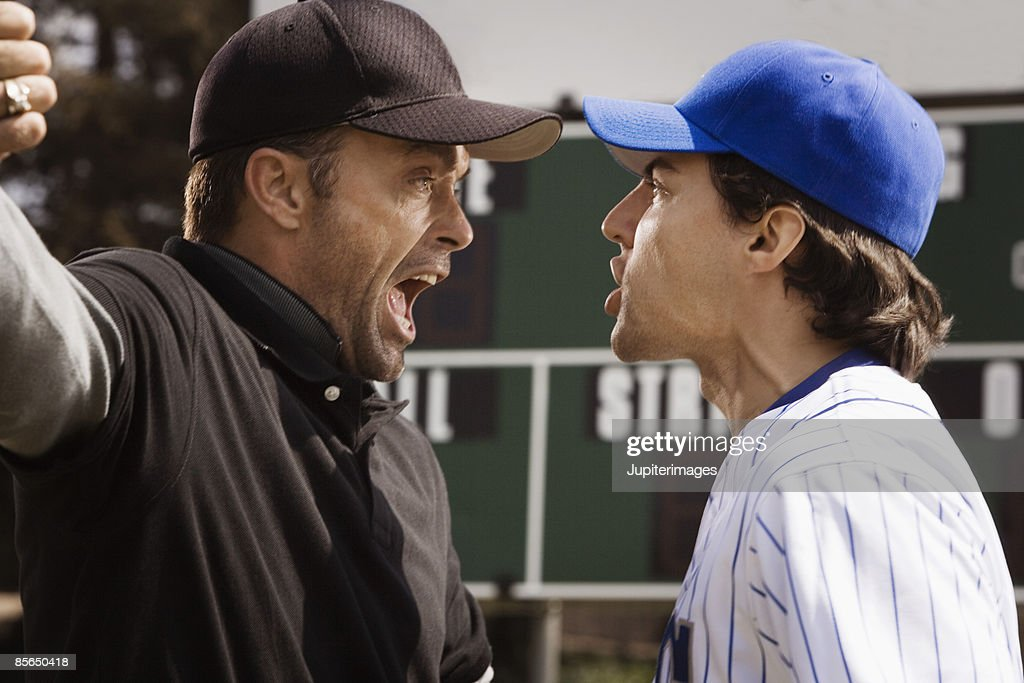 Umpire and baseball player arguing