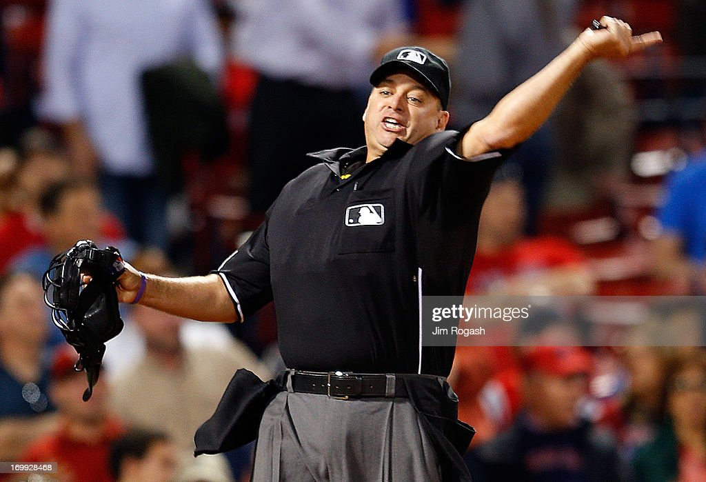 Umpire Andy Fletcher ejects Mike Carp #37 of the Boston Red Sox in the 8th inning during a game with the Texas Rangers at Fenway Park on June 4, 2013 in Boston, Massachusetts.