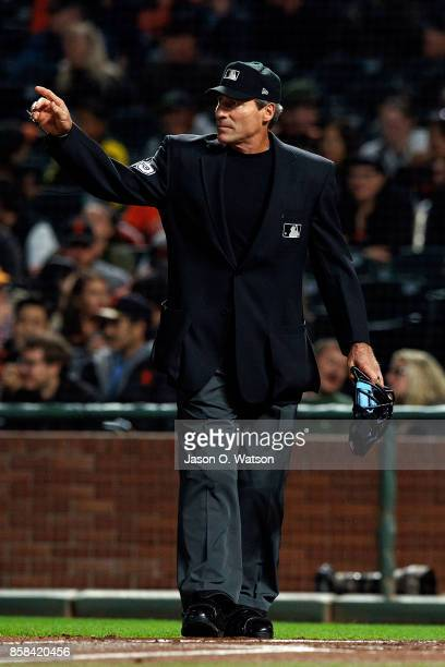 MLB umpire Angel Hernandez stands on the field during the first inning between the San Francisco Giants and the San Diego Padres at ATT Park on...