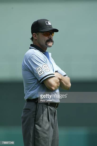 Umpire Bill Hohn stands on the field during the game between the Los Angeles Angels of Anaheim and the Texas Rangers at Angel Stadium in Anaheim...