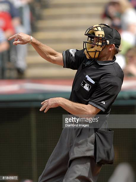 Umpire Bill Hohn throws a ball to the pitcher during a game between the Cleveland Indians and Texas Rangers on Sunday May 25 2008 at Progressive...