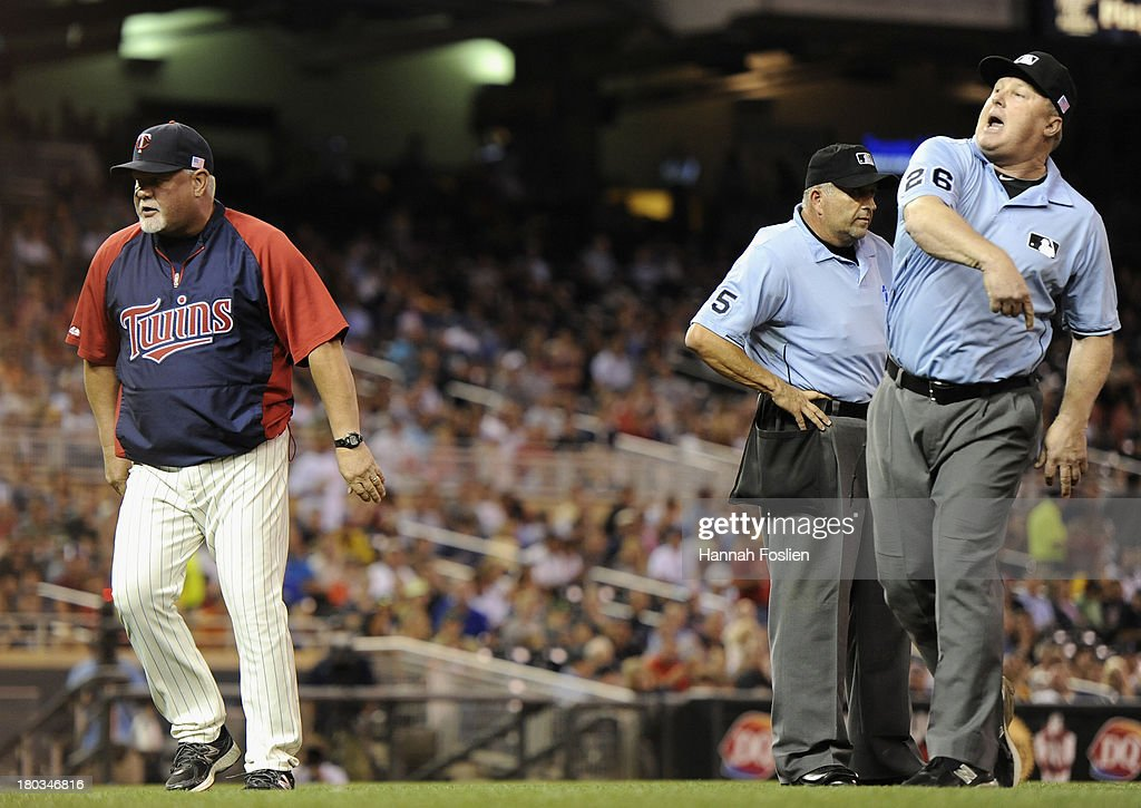 Umpire Bill Miller #26 ejects <a gi-track='captionPersonalityLinkClicked' href=/galleries/search?phrase=Ron+Gardenhire&family=editorial&specificpeople=220870 ng-click='$event.stopPropagation()'>Ron Gardenhire</a> #35 of the Minnesota Twins as umpire <a gi-track='captionPersonalityLinkClicked' href=/galleries/search?phrase=Dale+Scott&family=editorial&specificpeople=243427 ng-click='$event.stopPropagation()'>Dale Scott</a> #5 looks on during the fourth inning of the game against the Oakland Athletics on September 11, 2013 at Target Field in Minneapolis, Minnesota.