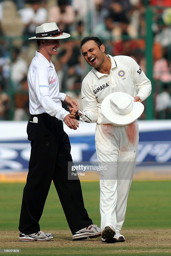 Umpire <a gi-track='captionPersonalityLinkClicked' href=/galleries/search?phrase=Billy+Bowden&family=editorial&specificpeople=228578 ng-click='$event.stopPropagation()'>Billy Bowden</a> and <a gi-track='captionPersonalityLinkClicked' href=/galleries/search?phrase=Virender+Sehwag&family=editorial&specificpeople=176591 ng-click='$event.stopPropagation()'>Virender Sehwag</a> (R) of India share a lighter moment during day four of the Second Test match between India and Australia at M.Chinnaswamy Stadium on October 12, 2010 in Bangalore, India.