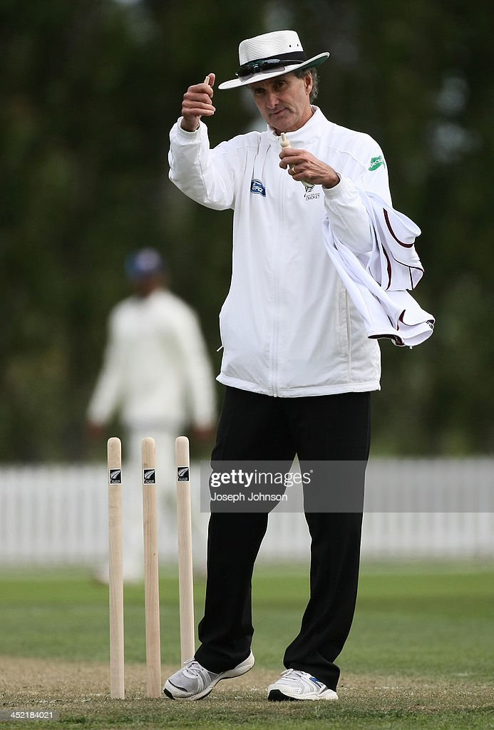 Umpire <a gi-track='captionPersonalityLinkClicked' href=/galleries/search?phrase=Billy+Bowden&family=editorial&specificpeople=228578 ng-click='$event.stopPropagation()'>Billy Bowden</a> calls stumps on day one of the tour match between New Zealand 'A' and the West Indies XI at Bert Sutcliffe Oval on November 27, 2013 , Lincoln University, Christchurch, New Zealand.