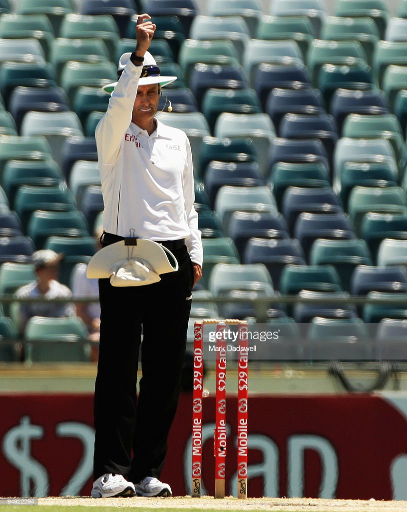 Umpire <a gi-track='captionPersonalityLinkClicked' href=/galleries/search?phrase=Billy+Bowden&family=editorial&specificpeople=228578 ng-click='$event.stopPropagation()'>Billy Bowden</a> raises his finger for the second time after getting the signal from the Third Umpire to dismiss Kemar Roach of the West Indies during the Third Test match between Australia and the West Indies at WACA on December 20, 2009 in Perth, Australia. Australia won the Test and the Series and retain the Frank Worrell Trophy.