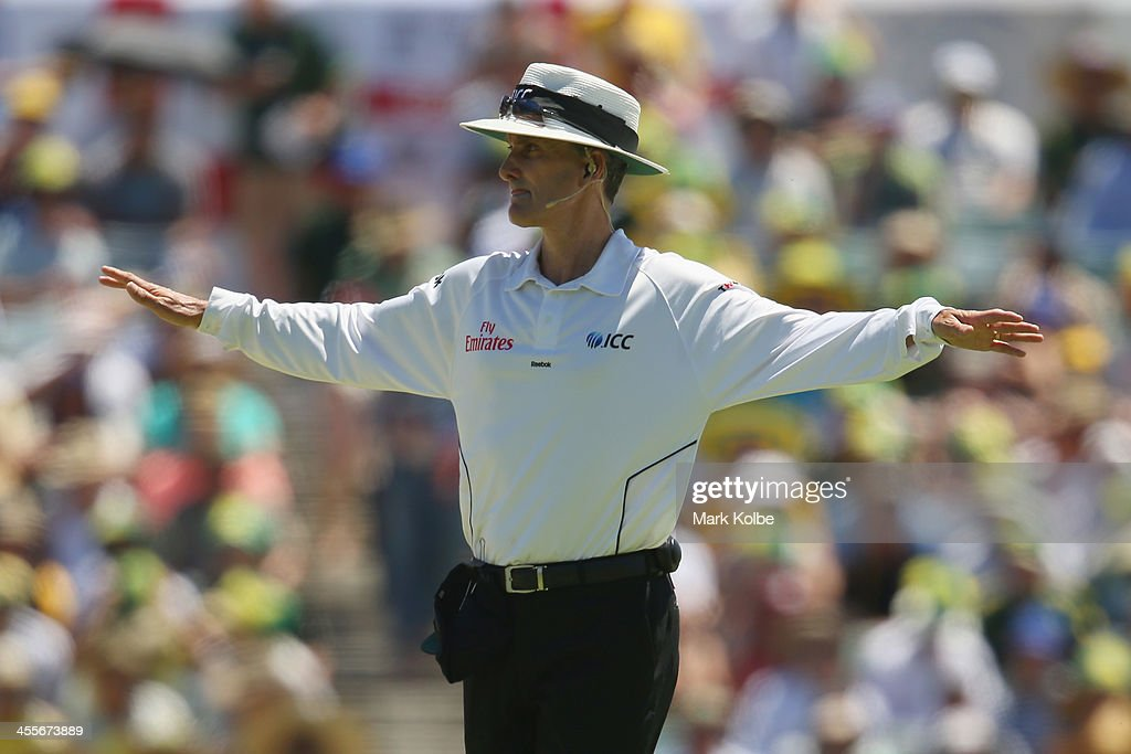 Umpire <a gi-track='captionPersonalityLinkClicked' href=/galleries/search?phrase=Billy+Bowden&family=editorial&specificpeople=228578 ng-click='$event.stopPropagation()'>Billy Bowden</a> signal a wide during day one of the Third Ashes Test Match between Australia and England at WACA on December 13, 2013 in Perth, Australia.