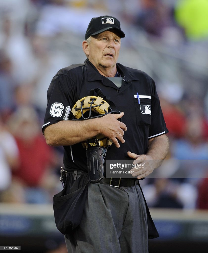 Umpire Bob Davidson looks on during the game between the Minnesota Twins and the Detroit Tigers on June 15 2013 at Target Field in Minneapolis...