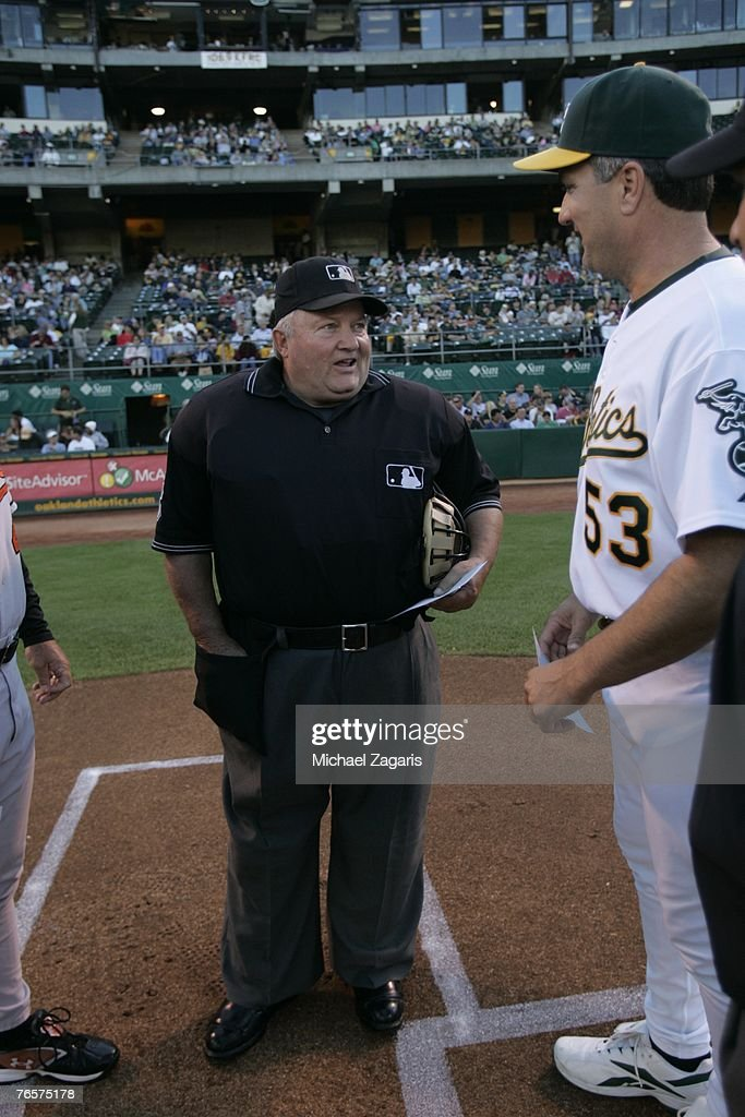 Umpire Bruce Froemming meets with Manager Bob Geren of the Oakland Athletics during the game against the Baltimore Orioles at the McAfee Coliseum in Oakland, California on July 20, 2007. The Orioles defeated the Athletics 6-1.