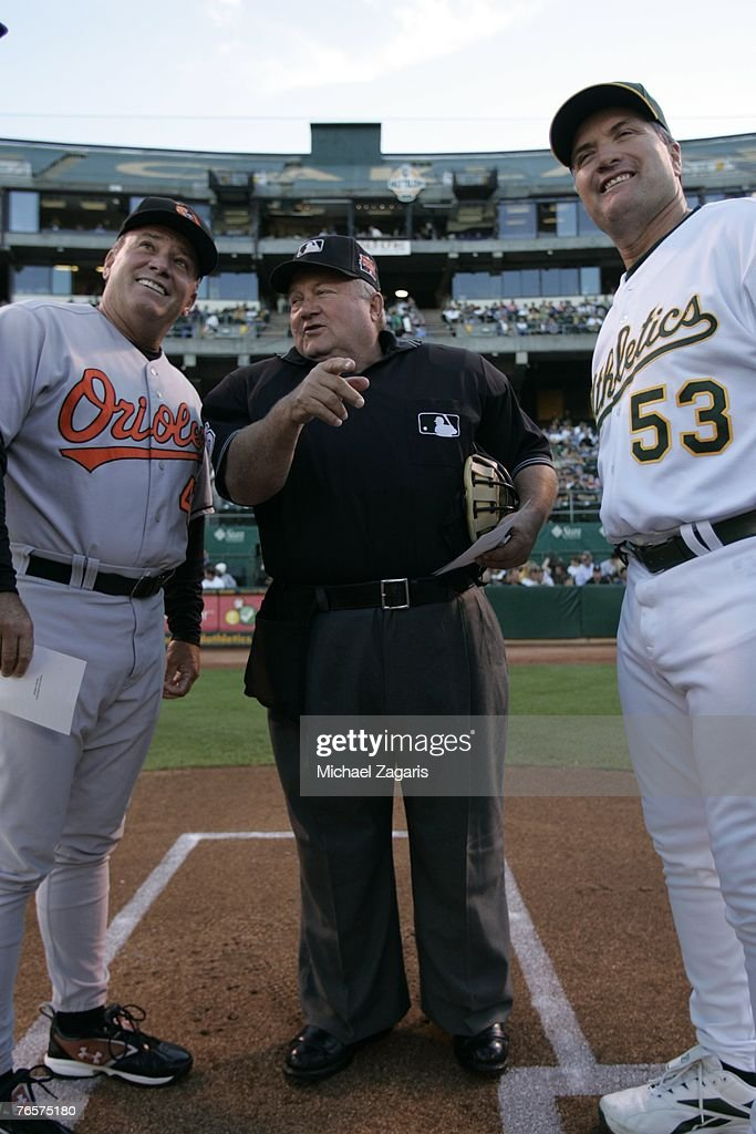 Umpire Bruce Froemming meets with Manager Bob Geren of the Oakland Athletics and Manager Dave Trembley of the Baltimore Orioles at the McAfee Coliseum in Oakland, California on July 20, 2007. The Orioles defeated the Athletics 6-1.
