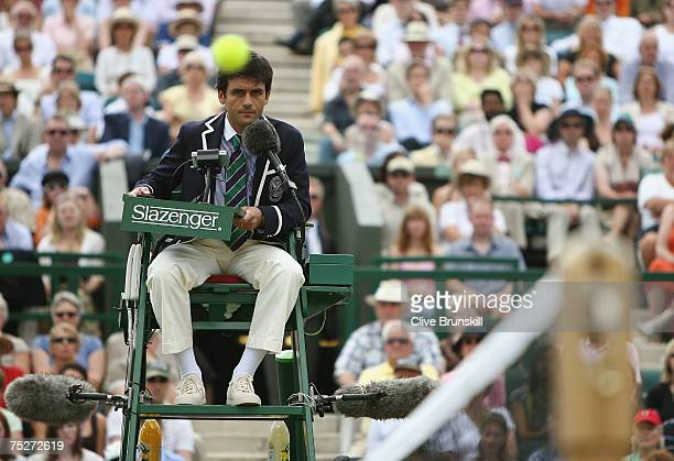 Umpire Carlos Rams looks on during the Men's Singles final match between Roger Federer of Switzerland and Rafael Nadal of Spain during day thirteen...