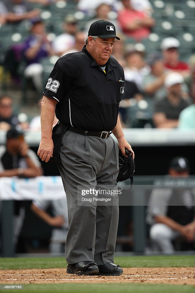 Umpire crew chief Joe West oversees the action at home plate as the Chicago White Sox face the Colorado Rockies during Interleague play at Coors...