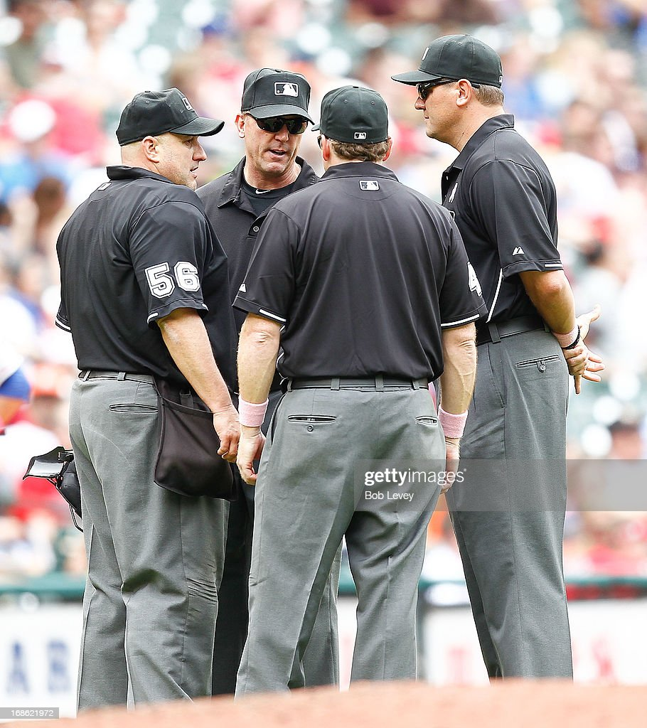 Umpire crew reviews a ball hit by Adrian Beltre #29 of the Texas Rangers as to whether it was a home run or not against the Houston Astros at Minute Maid Park on May 12, 2013 in Houston, Texas.