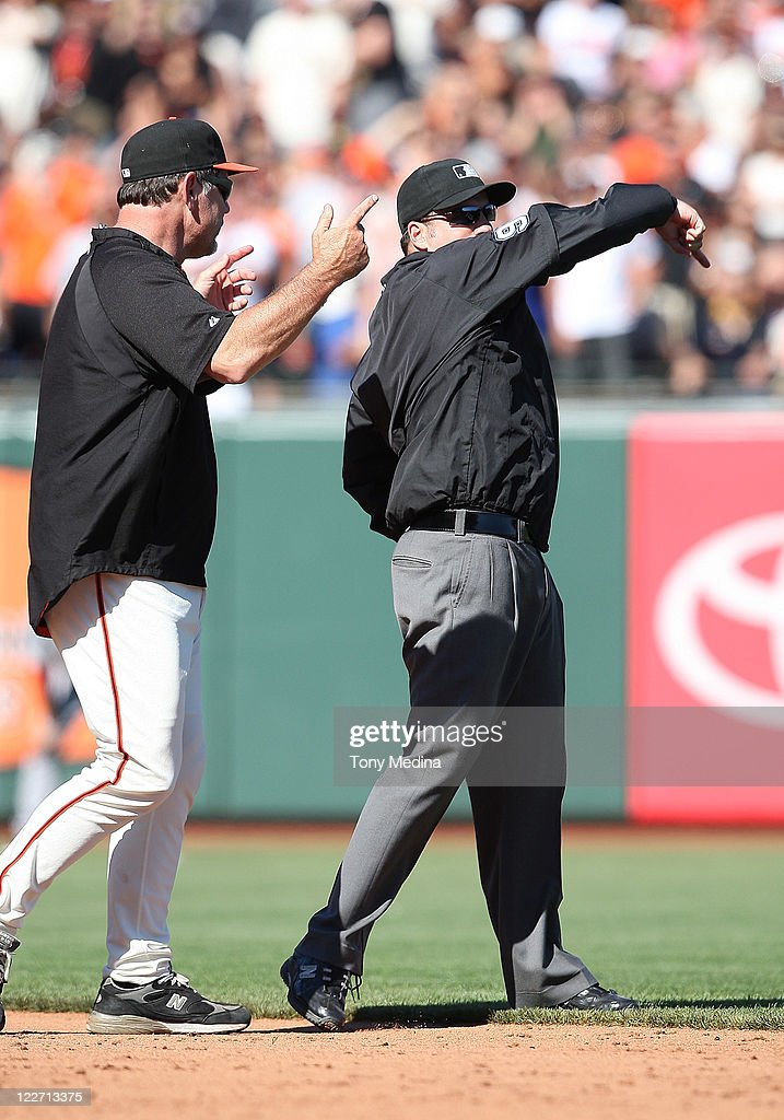 Umpire Dan Bellino #93 ejects manager <a gi-track='captionPersonalityLinkClicked' href=/galleries/search?phrase=Bruce+Bochy&family=editorial&specificpeople=220291 ng-click='$event.stopPropagation()'>Bruce Bochy</a> #16 of the San Francisco Giants from the game in the bottom of the tenth inning during a game between the Houston Astros and the San Francisco Giants at AT&T Park on August 28, 2011 in San Francisco, California.