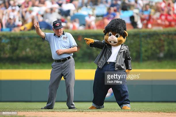 Umpire dances with mascot during the Little league World Series at Lamade Stadium in Williamsports Pennsylvania on August 25 2007