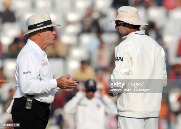 Umpire Daryl Harper speaks with India Yuvraj Singh during the third day of the second test at the Punjab Cricket Association Stadium Mohali India