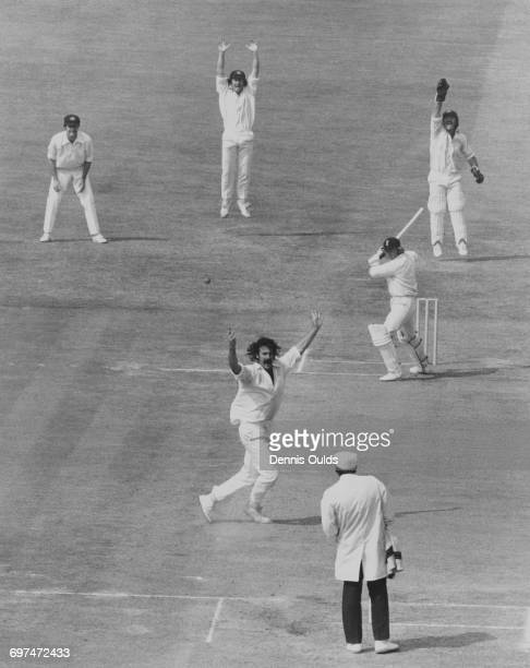 Umpire Dickie Bird looks on as Australian fast bowler Dennis Lillee wicket keeper Rodney Marsh with slips Greg and Ian Chappell appeal for a leg...