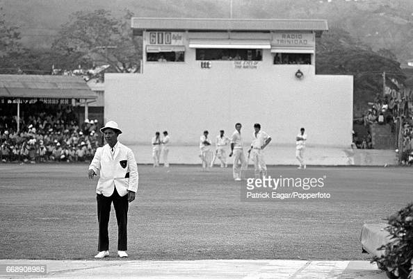 Umpire Douglas Sang Hue sorting out a sightscreen problem during the 3rd Test match between West Indies and Australia at the Queen's Park Oval...