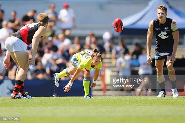 Umpire Eleni Glouftsis becoming the first female field umpire to adjudicate an official AFL match today bounces the ball during the 2016 AFL NAB...