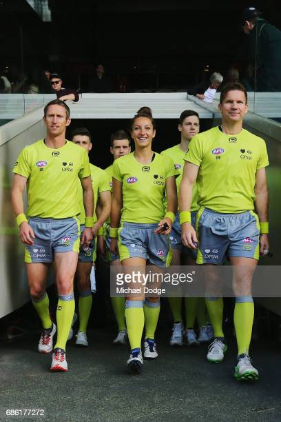 Umpire Ellen Glouftsis making her debut as the first ever women to umpire an AFL match walks out during the round nine AFL match between the Essendon...
