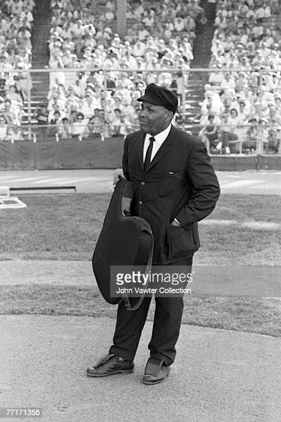 Umpire Emmett Ashford awaits the start of the first game of a doubleheader on July 31 1966 between the Detroit Tigers and the Kansas City A's at...