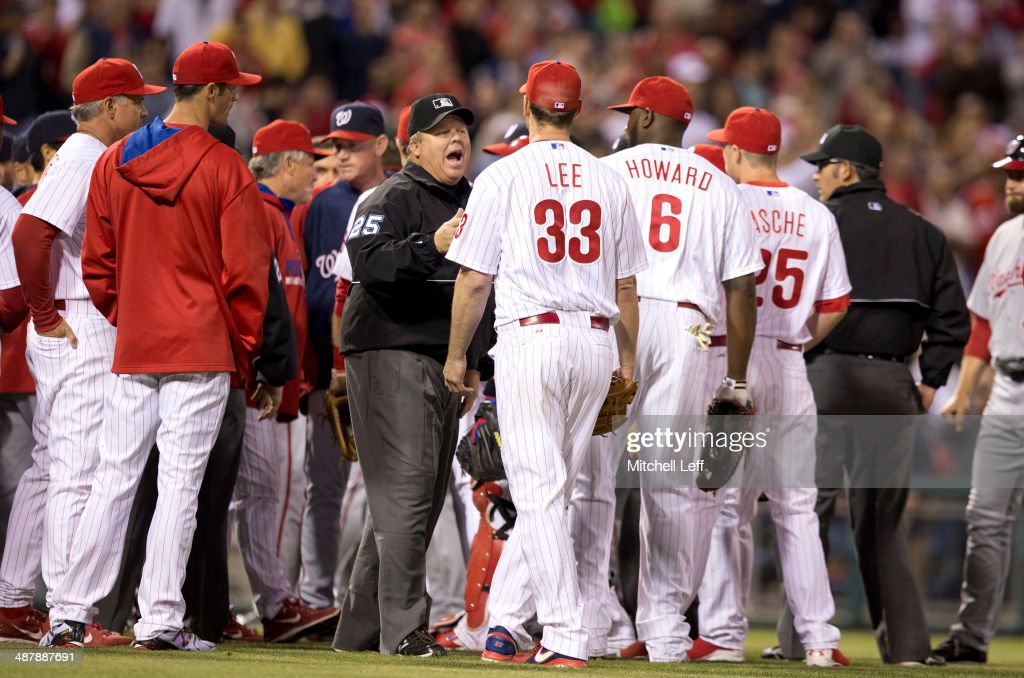 Umpire Fieldin Cuthbreth #25 talks to pitcher <a gi-track='captionPersonalityLinkClicked' href=/galleries/search?phrase=Cliff+Lee&family=editorial&specificpeople=218092 ng-click='$event.stopPropagation()'>Cliff Lee</a> #33 of the Philadelphia Phillies after both benches clear during the fifth inning against the Washington Nationals on May 2, 2014 at Citizens Bank Park in Philadelphia, Pennsylvania.