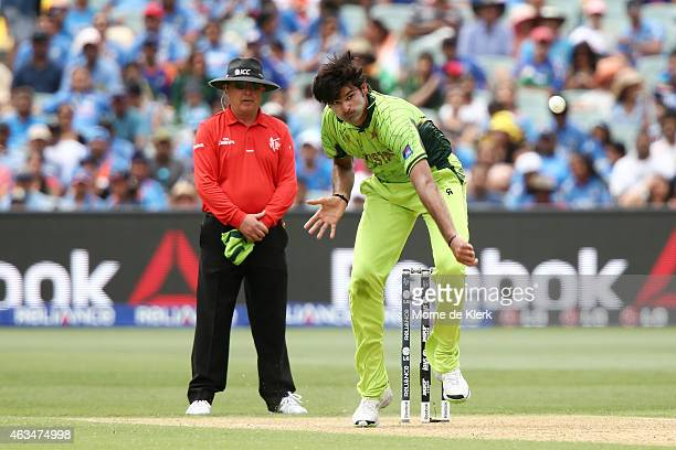 Umpire Ian Gould looks on as Muhammad Irfan of Pakistan bowles during the 2015 ICC Cricket World Cup match between India and Pakistan at Adelaide...