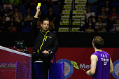 Umpire issue a yellow card to Mathias Boe of Denmark during the match between Mathias Boe and Carsten Mogensen of Denmark and Mohammad Ahsan and...