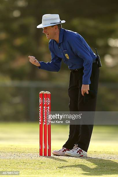 Umpire James Hewitt sets the guard for a batsman during the Futures League match between Western Australia and Victoria at Stevens Reserve on October...
