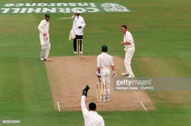 Umpire Javed Akhtar raises his finger at South Africa's Gary Kirsten to signal him out LBW to England's Angus Fraser