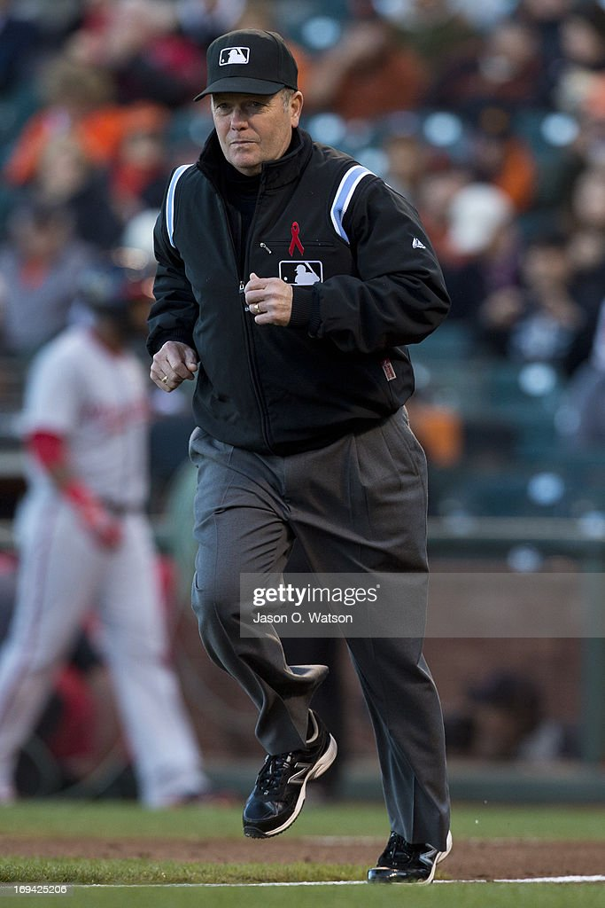 MLB umpire Jerry Meals runs to third base before the game between the San Francisco Giants and the Washington Nationals at AT&T Park on May 21, 2013 in San Francisco, California. The San Francisco Giants defeated the Washington Nationals 4-2 in 10 innings.