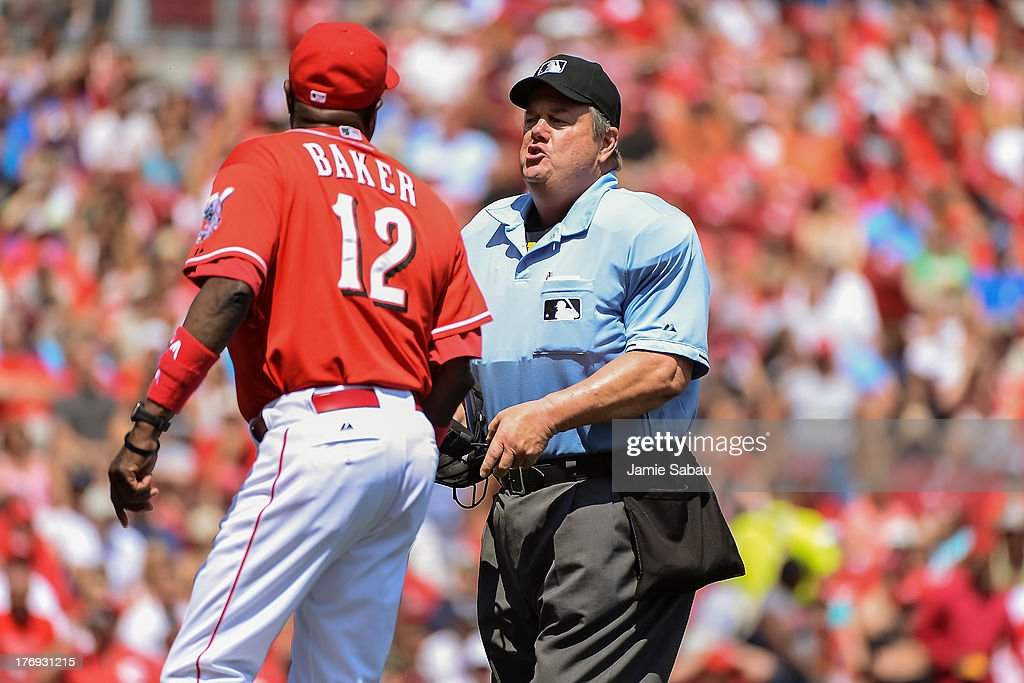 Umpire Joe West argues a call with Manager Dusty Baker of the Cincinnati Reds during a game against the San Diego Padres at Great American Ball Park...