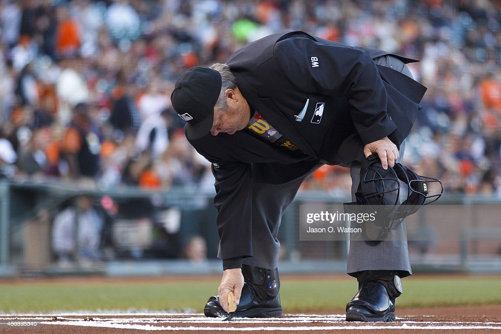 MLB umpire Joe West brushes off home plate before the game between the San Francisco Giants and the New York Mets at ATT Park on June 7 2014 in San...