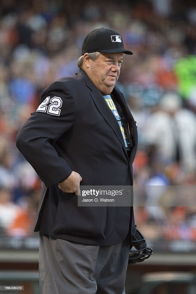MLB umpire Joe West stands behind home plate during the first inning between the San Francisco Giants and the Los Angeles Dodgers at ATT Park on May...