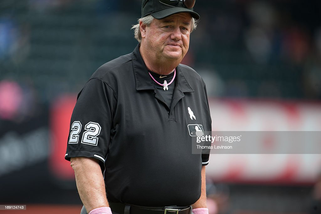 Umpire Joe West wearing Breast Cancer Awareness gear during the game New York Mets against the Pittsburgh Pirates on May 12 2013 at Citi Field in the...
