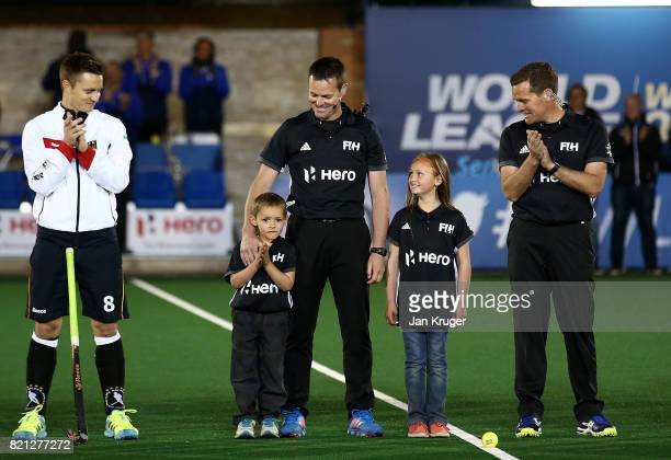 Umpire John Wright of South Africa stands with his children and brother Mark ahead of officiating his last match during day 9 of the FIH Hockey World...