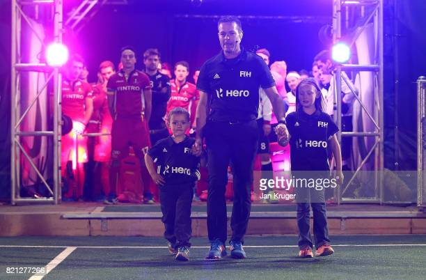 Umpire John Wright of South Africa walks out with his children officiating his last match during day 9 of the FIH Hockey World League Men's Semi...