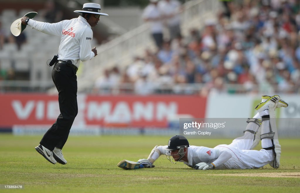 Umpire Kumar Dharmasena takes evasive action as <a gi-track='captionPersonalityLinkClicked' href=/galleries/search?phrase=Stuart+Broad&family=editorial&specificpeople=574360 ng-click='$event.stopPropagation()'>Stuart Broad</a> of England dives to make his ground during day three of the 1st Investec Ashes Test match between England and Australia at Trent Bridge Cricket Ground on July 12, 2013 in Nottingham, England.