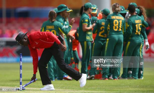 Umpire Langton Rusere replaces the stumps after wicket keeper Trisha Chetty of South Africa stumped Bismah Maroof of Pakistan during the ICC Women's...