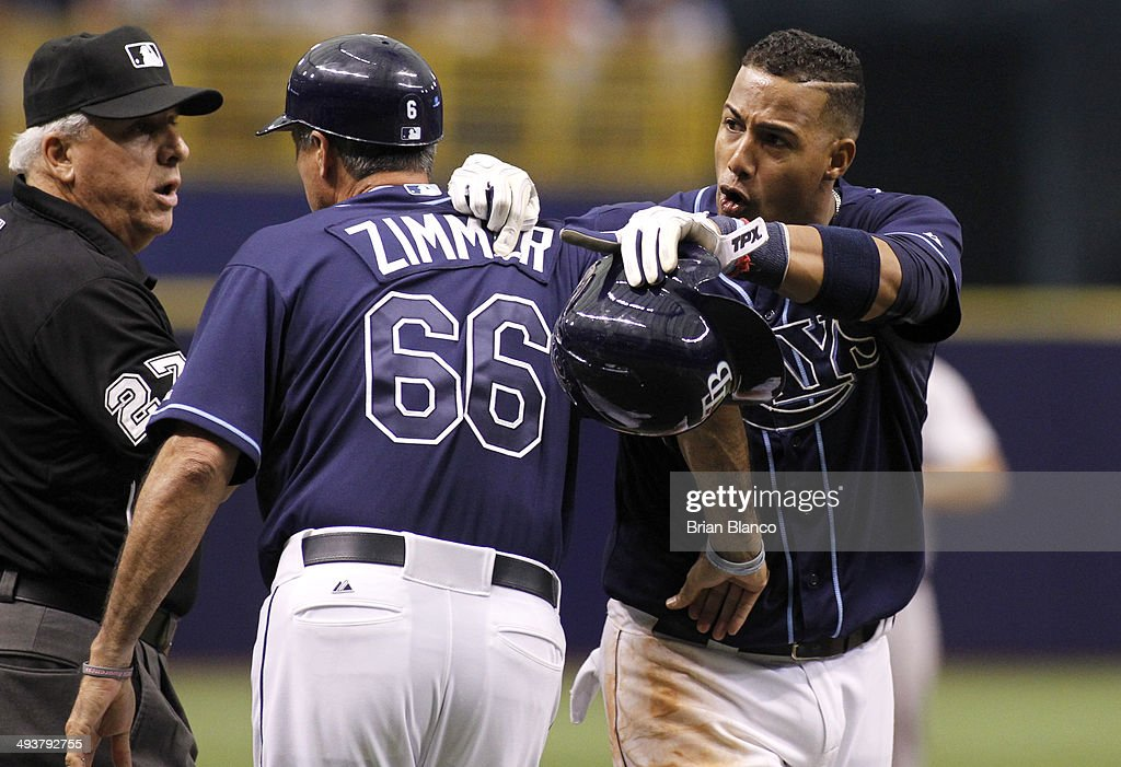 Umpire Larry Vanover #27 and third base coach Tom Foley (C) of the Tampa Bay Rays (wearing a jersey in honor of coach <a gi-track='captionPersonalityLinkClicked' href=/galleries/search?phrase=Don+Zimmer&family=editorial&specificpeople=215376 ng-click='$event.stopPropagation()'>Don Zimmer</a> #66 of the Tampa Bay Rays) attempts to hold back <a gi-track='captionPersonalityLinkClicked' href=/galleries/search?phrase=Yunel+Escobar&family=editorial&specificpeople=757358 ng-click='$event.stopPropagation()'>Yunel Escobar</a> #11 of the Tampa Bay Rays as he argues with the Boston Red Sox bench moments before a bench-clearing brawl during the seventh inning of a game on May 25, 2014 at Tropicana Field in St. Petersburg, Florida.