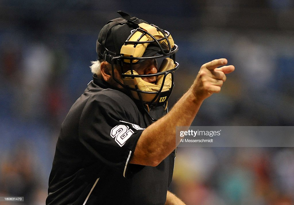 Umpire Larry Vanover calls a strike as the Tampa Bay Rays play against the Texas Rangers September 16 2013 at Tropicana Field in St Petersburg...