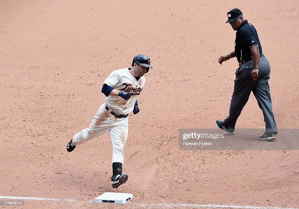 Umpire Laz Diaz looks on as Brian Dozier of the Minnesota Twins rounds third base after hitting a tworun home run against the Baltimore Orioles...