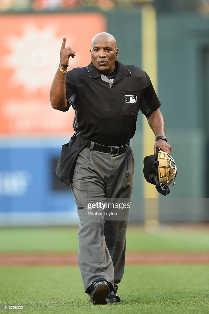 Umpire Laz Diaz looks on during game two of a doubleheader baseball game between the Baltimore Orioles and the Tampa Bay Rays at Oriole Park at...