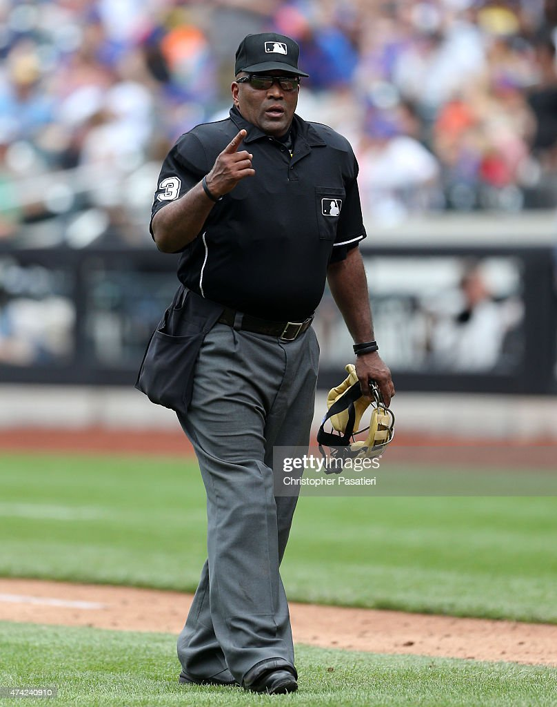 Umpire Laz Diaz looks on in between innings during the game between the Milwaukee Brewers and New York Mets at Citi Field on May 17 2015 in the...