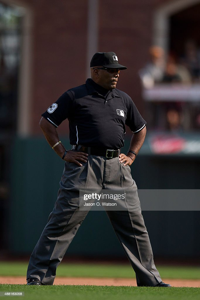 MLB umpire Laz Diaz stands on the field during the eighth inning between the San Francisco Giants and the San Diego Padres at ATT Park on September...
