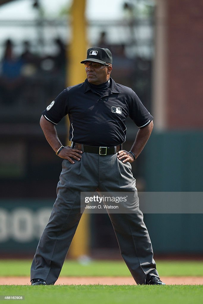 MLB umpire Laz Diaz stands on the field during the fourth inning between the San Francisco Giants and the San Diego Padres at ATT Park on September...