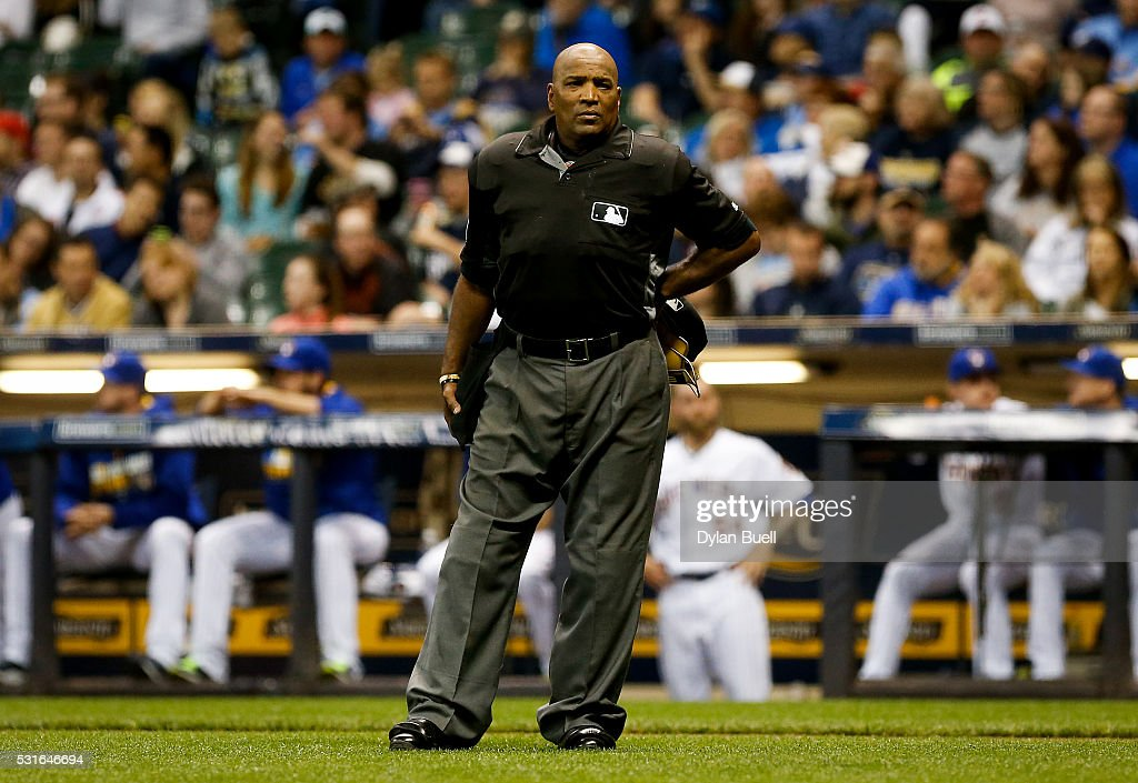 Umpire Laz Diaz waits to hear the verdict of a video review during the game between the San Diego Padres and Milwaukee Brewers at Miller Park on May...