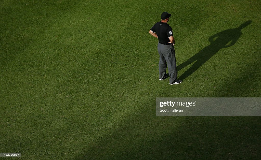 MLB umpire Mark Carlson is seen at third base during the game between the Chicago White Sox and the Houston Astros at Minute Maid Park on May 17, 2014 in Houston, Texas.