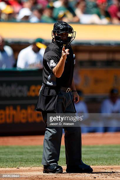 MLB umpire Mark Wegner calls a strike during the second inning between the Oakland Athletics and the Seattle Mariners at the Oakland Coliseum on...